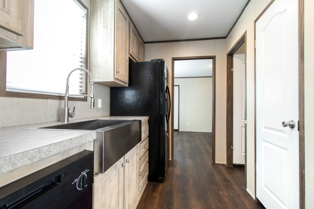 The ANNIVERSARY 16763A Kitchen. This Manufactured Mobile Home features 3 bedrooms and 2 baths.