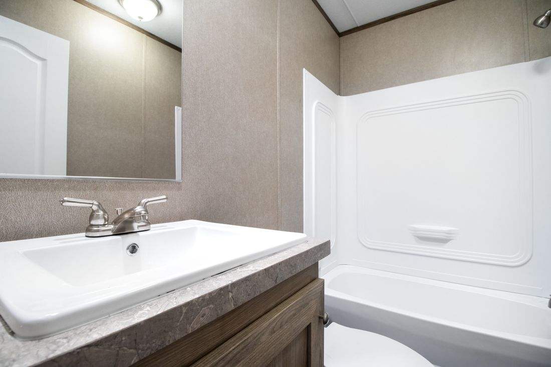 The ANNIVERSARY 16763A Guest Bathroom. This Manufactured Mobile Home features 3 bedrooms and 2 baths.