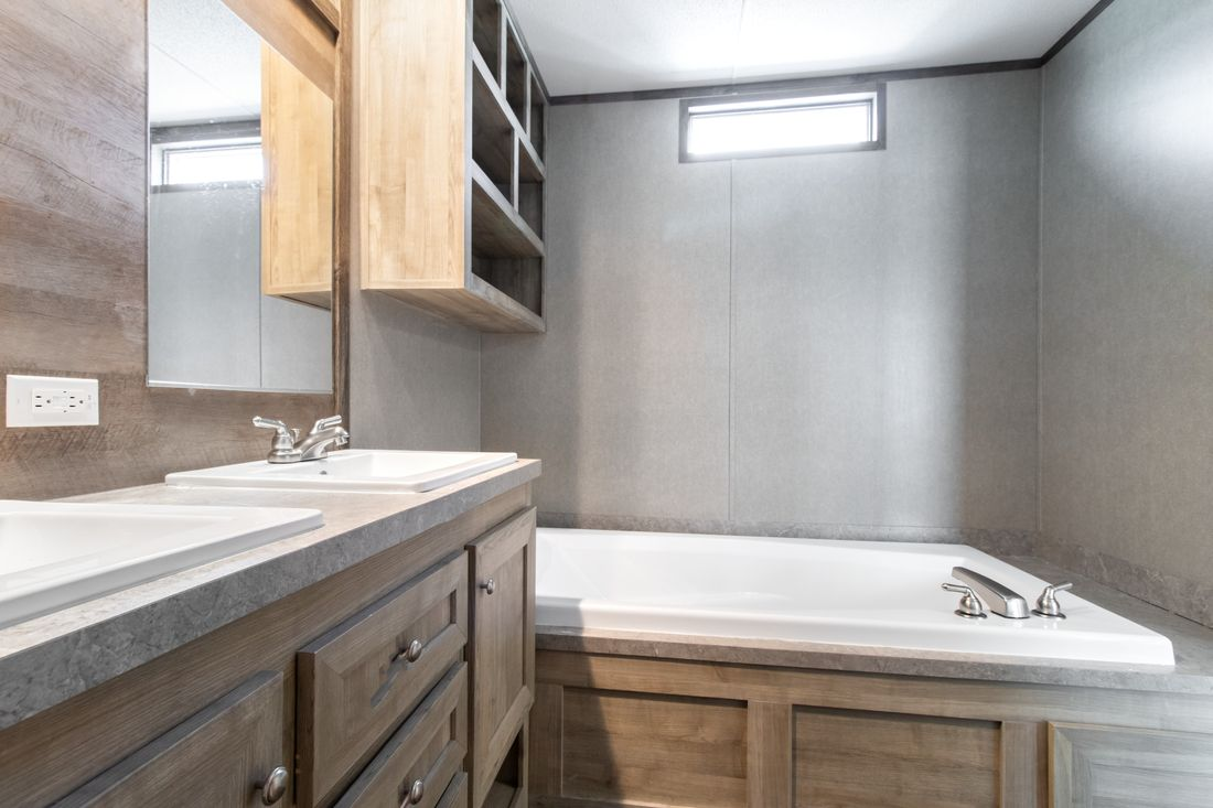 The ANNIVERSARY 16682A Master Bathroom. This Manufactured Mobile Home features 2 bedrooms and 2 baths.