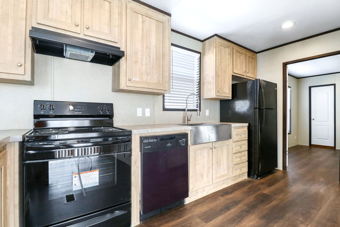 The ANNIVERSARY 16682A Kitchen. This Manufactured Mobile Home features 2 bedrooms and 2 baths.