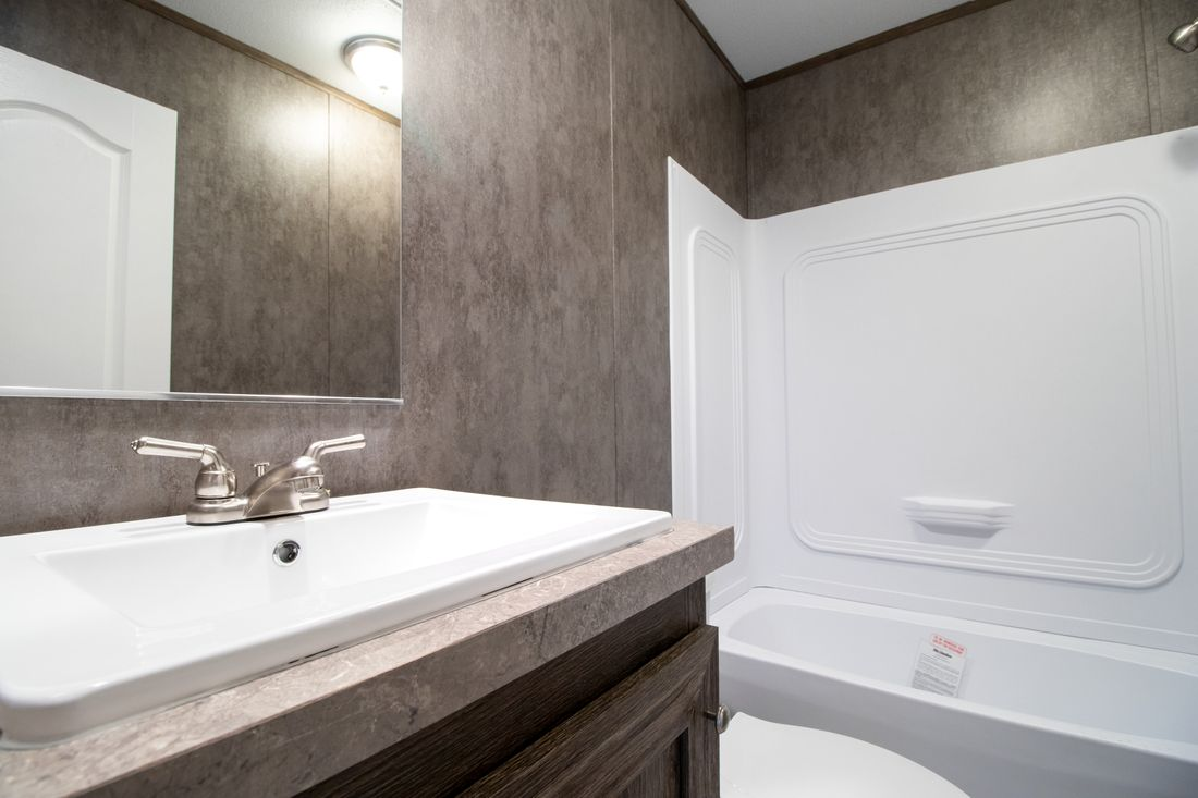 The ANNIVERSARY 16763I Guest Bathroom. This Manufactured Mobile Home features 3 bedrooms and 2 baths.