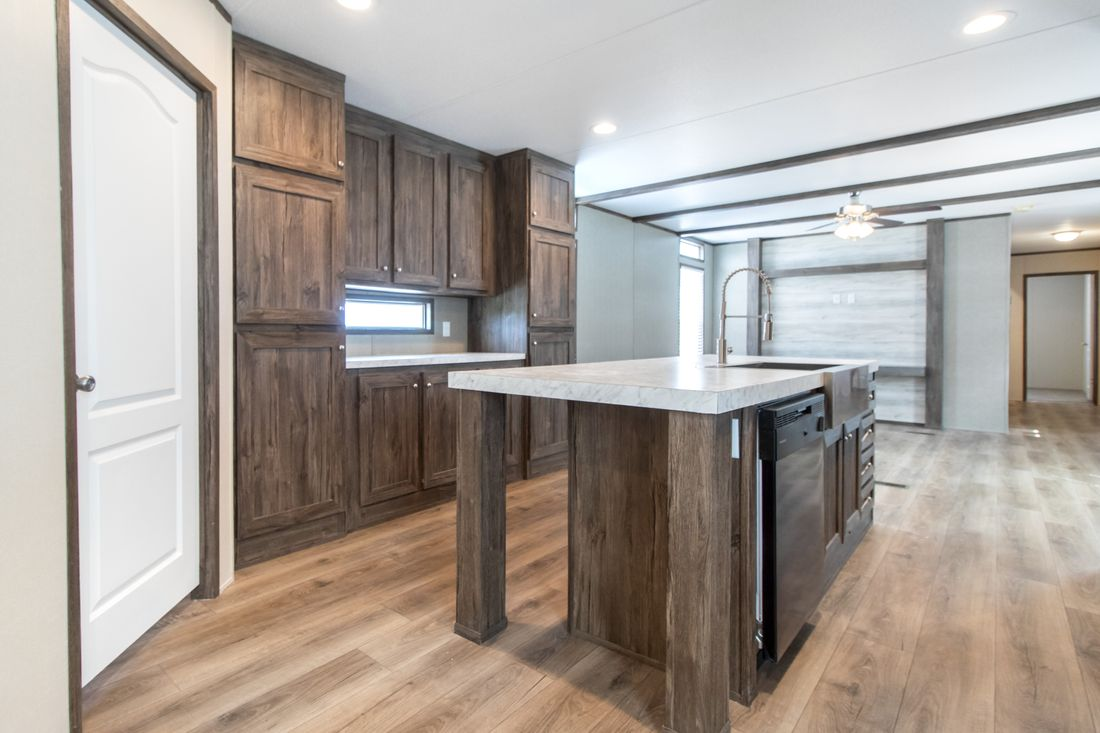 The ANNIVERSARY 16763S Kitchen. This Manufactured Mobile Home features 3 bedrooms and 2 baths.