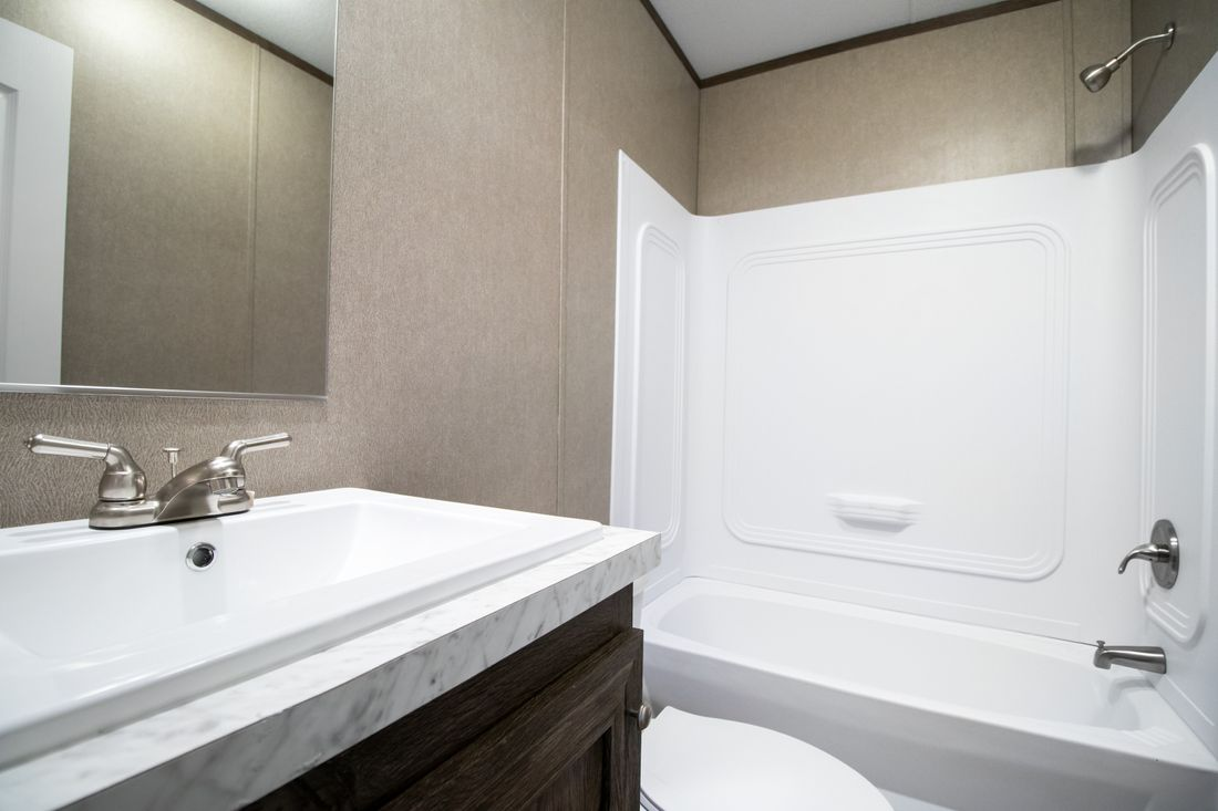 The ANNIVERSARY 16763S Guest Bathroom. This Manufactured Mobile Home features 3 bedrooms and 2 baths.