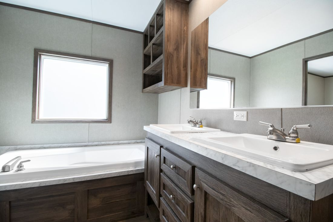 The ANNIVERSARY 16763S Master Bathroom. This Manufactured Mobile Home features 3 bedrooms and 2 baths.