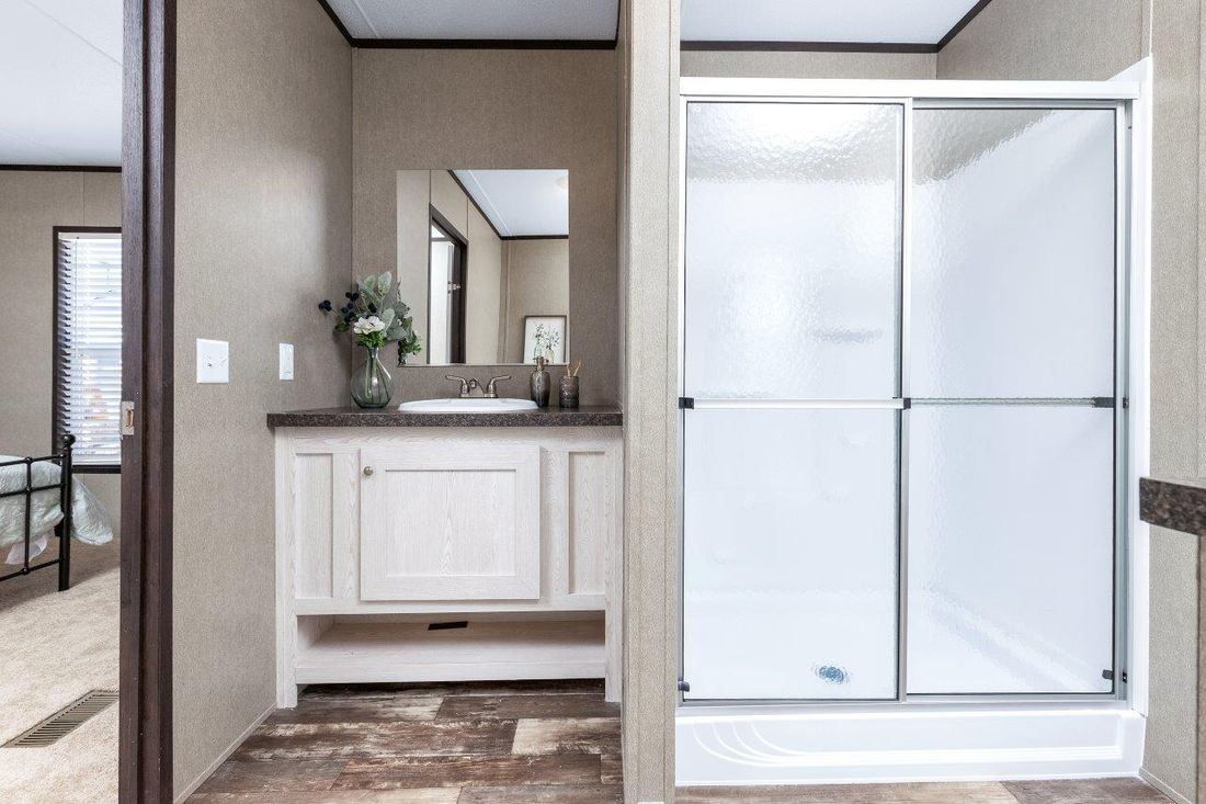 The CHALLENGER 16763B Master Bathroom. This Manufactured Mobile Home features 3 bedrooms and 2 baths.