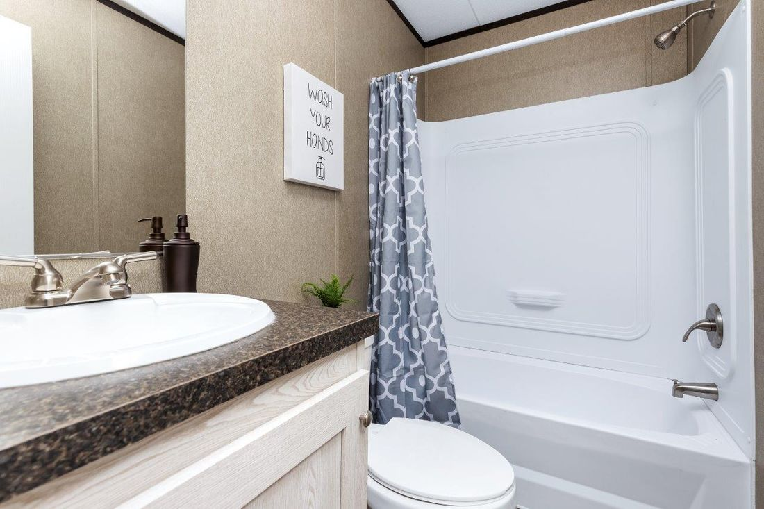 The CHALLENGER 16763B Guest Bathroom. This Manufactured Mobile Home features 3 bedrooms and 2 baths.