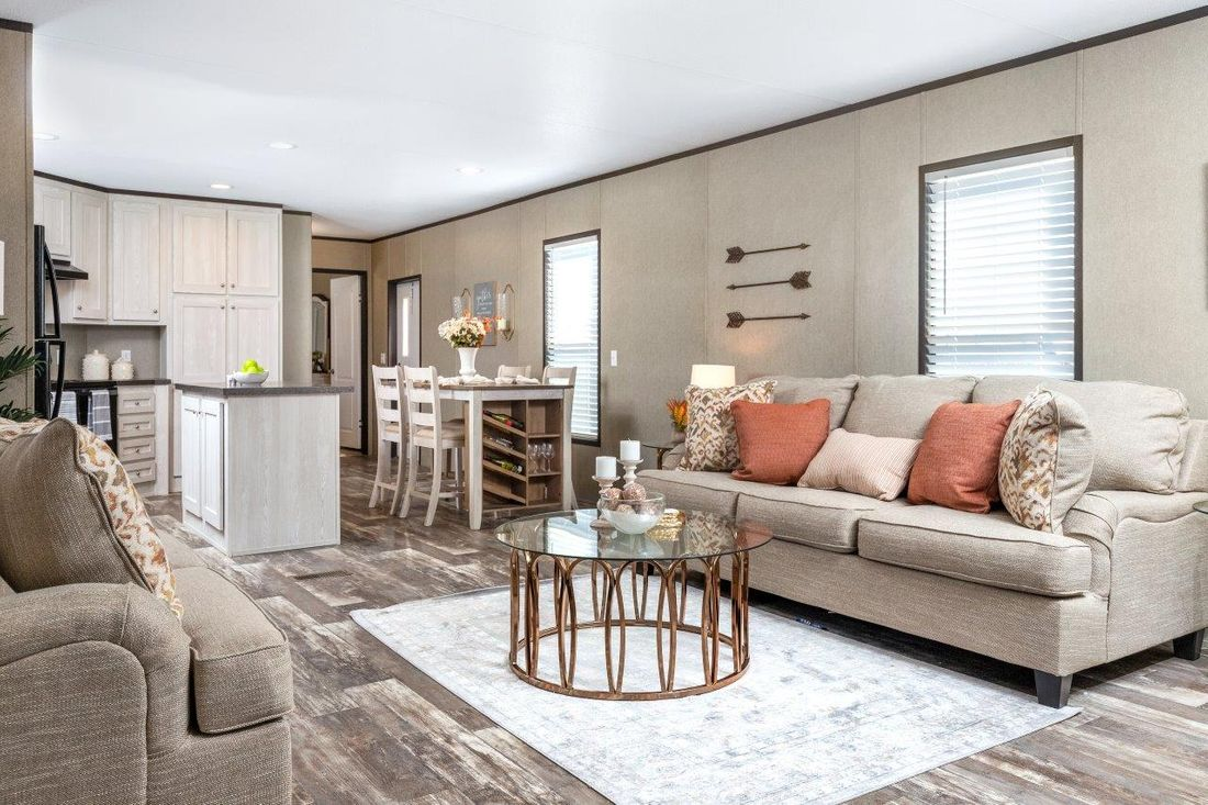 The CHALLENGER 16763B Living Room. This Manufactured Mobile Home features 3 bedrooms and 2 baths.