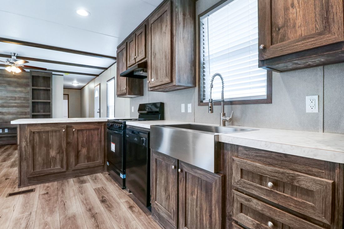 The ANNIVERSARY 16683B Kitchen. This Manufactured Mobile Home features 3 bedrooms and 2 baths.